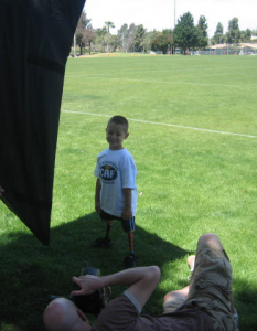 Tim Mantoani photographing a young CAF athlete.