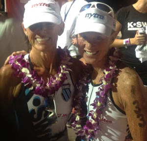 Kathleen and Julie at the finish line in Kona on October 13, 2012