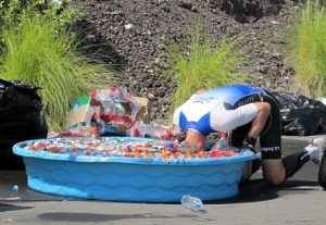 How hot was it? So hot that when you spot a tub of ice, you jump off your bike, and DUNK!