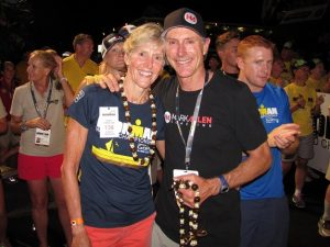 Iron Warriors Cherie Gruenfeld, with 13 age group wins, and Mark Allen, with 6 Ironman World Titles, together at the greatest finish line in the sport, as the midnight hour approaches